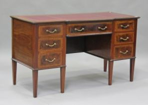An Edwardian mahogany twin pedestal desk, fitted with seven drawers, height 77cm, width 137cm, depth