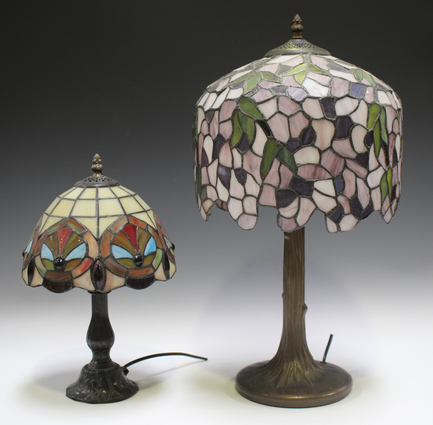 A modern Tiffany style table lamp with a stained and leaded glass domed shade, height 53cm, together