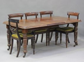 A late Victorian mahogany extending dining table with single extra leaf, on turned legs and castors,