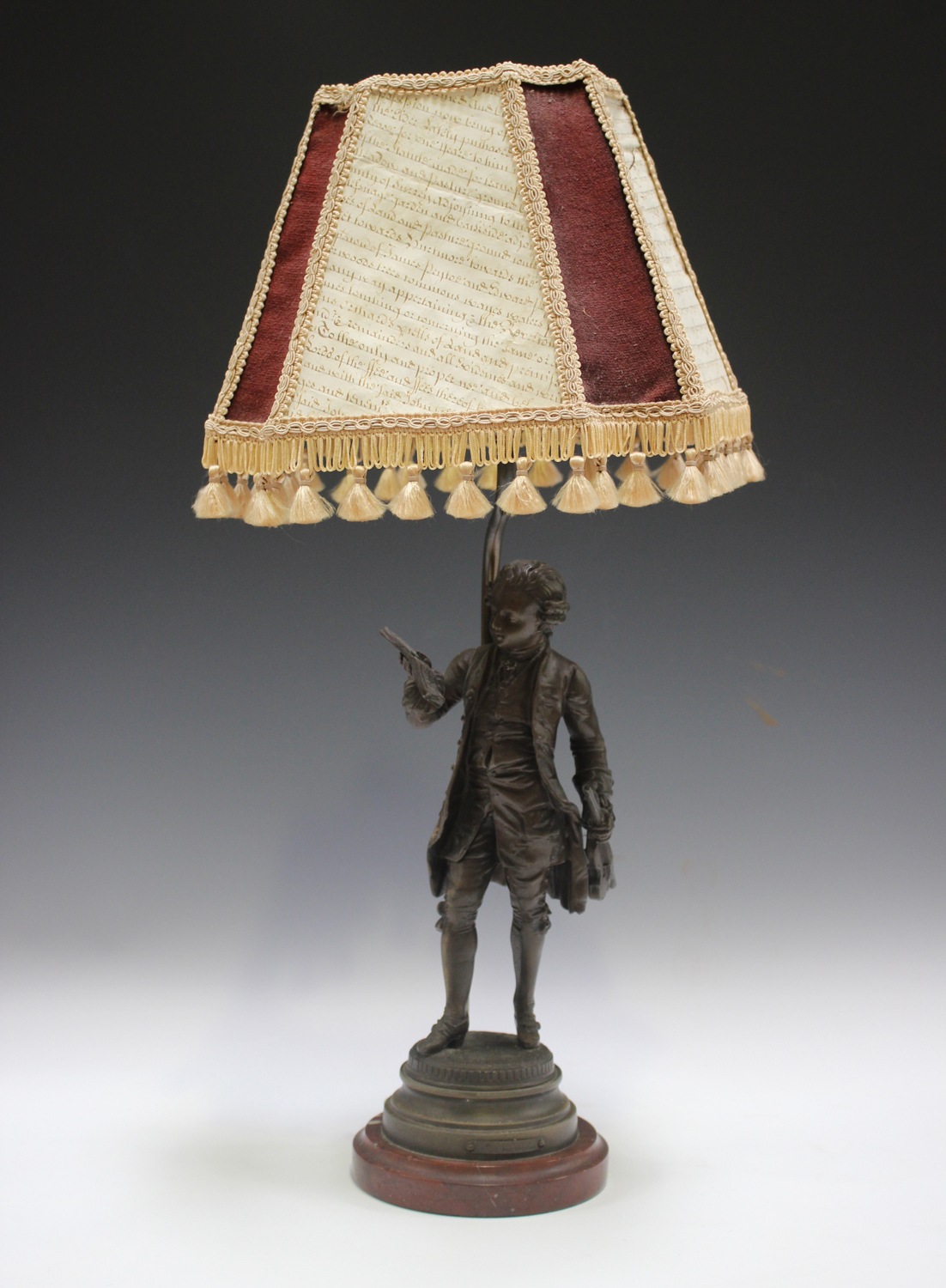 An early 20th century French cast spelter figural table lamp, modelled after Emile Bruchon as the