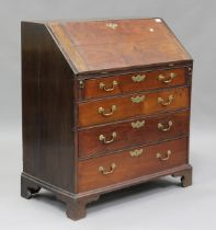 A George III mahogany bureau, the fall-front above four long drawers, on bracket feet, height 101cm,