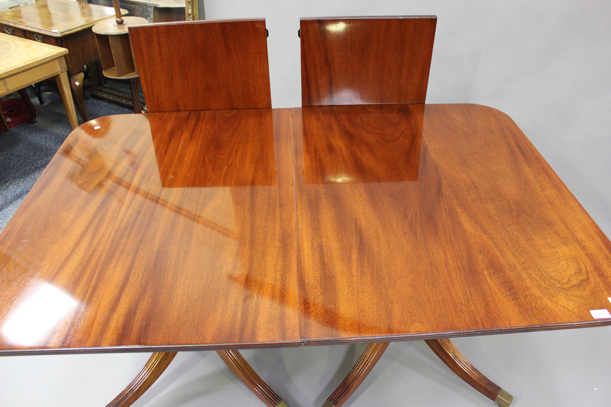 A 20th century George III style mahogany twin pedestal dining table with two extra leaves, height - Image 4 of 4