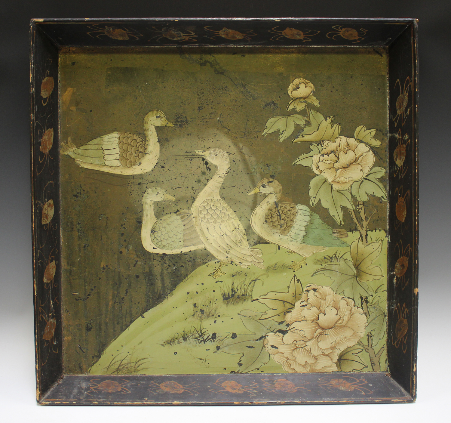 An early 20th century Chinese lacquered gallery tray, painted with ducks at a lakeside, width 54cm.