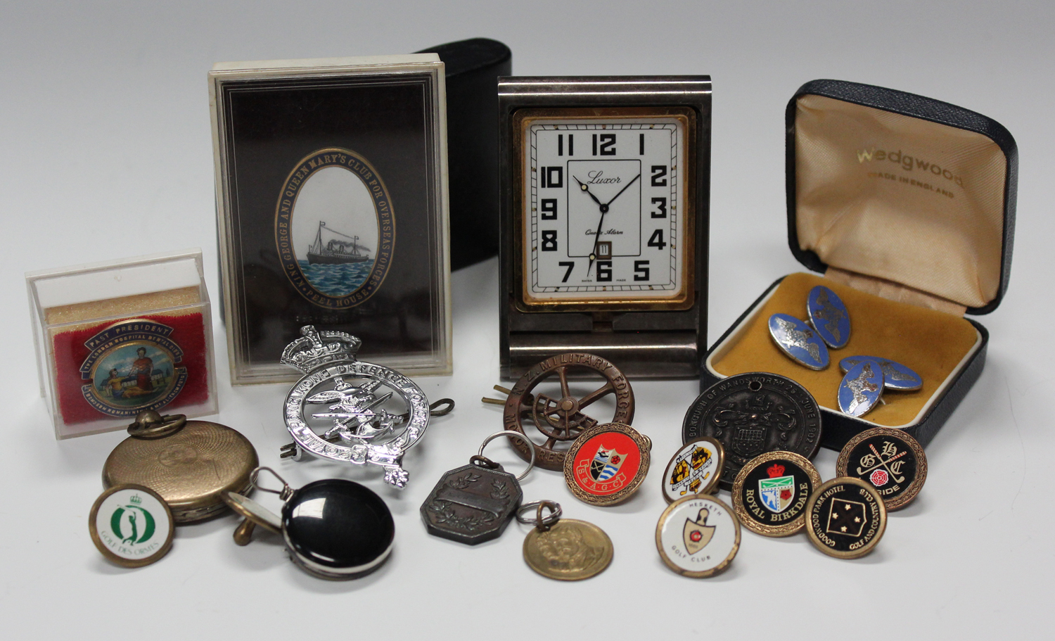 A small group of collectors' items, including a pair of enamelled R.A.F. cufflinks, a 'Peel House