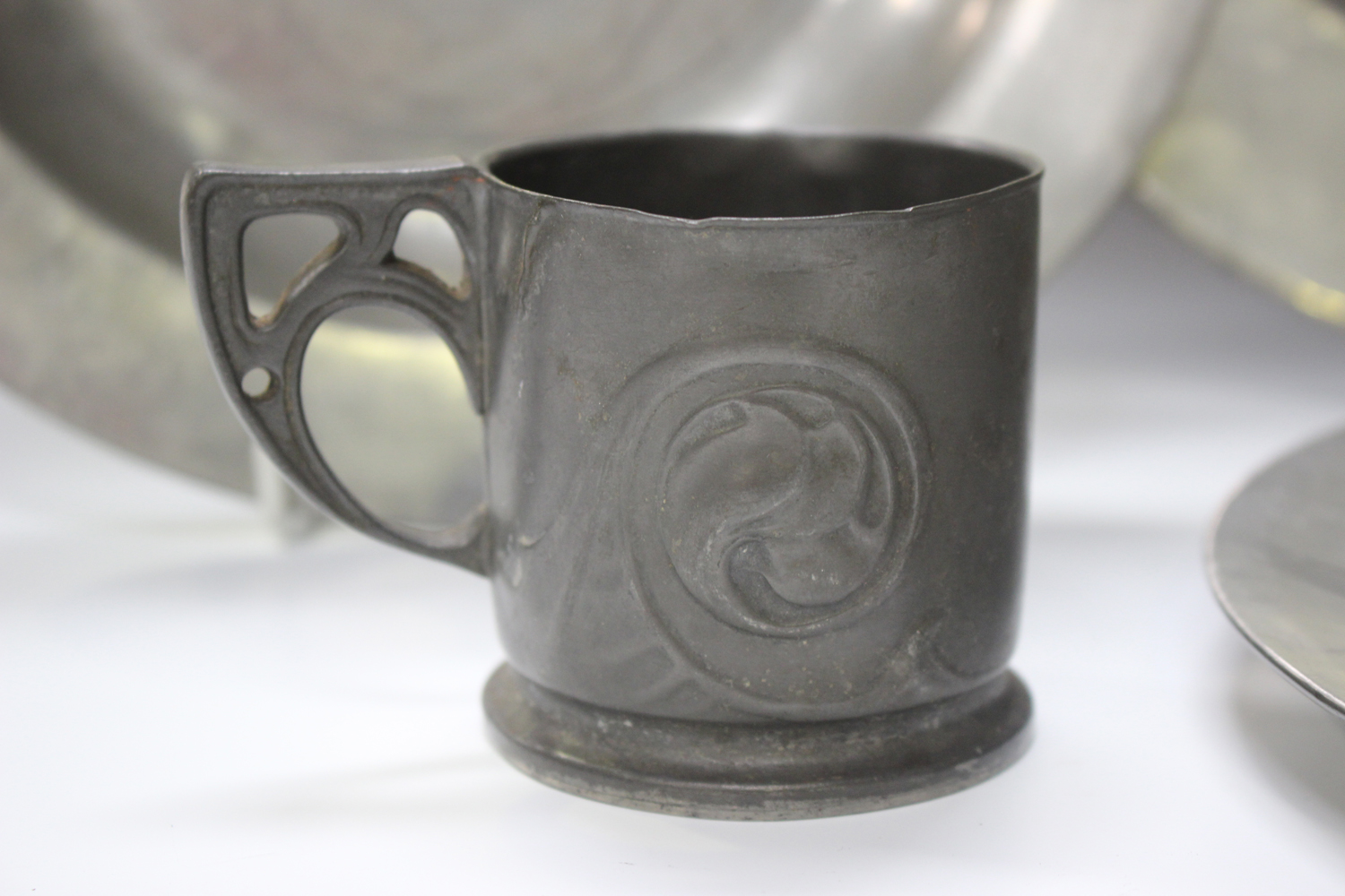 A small group of pewter items, comprising a Liberty 'Tudric' cup, model number '0558', height 6.5cm, - Image 11 of 11