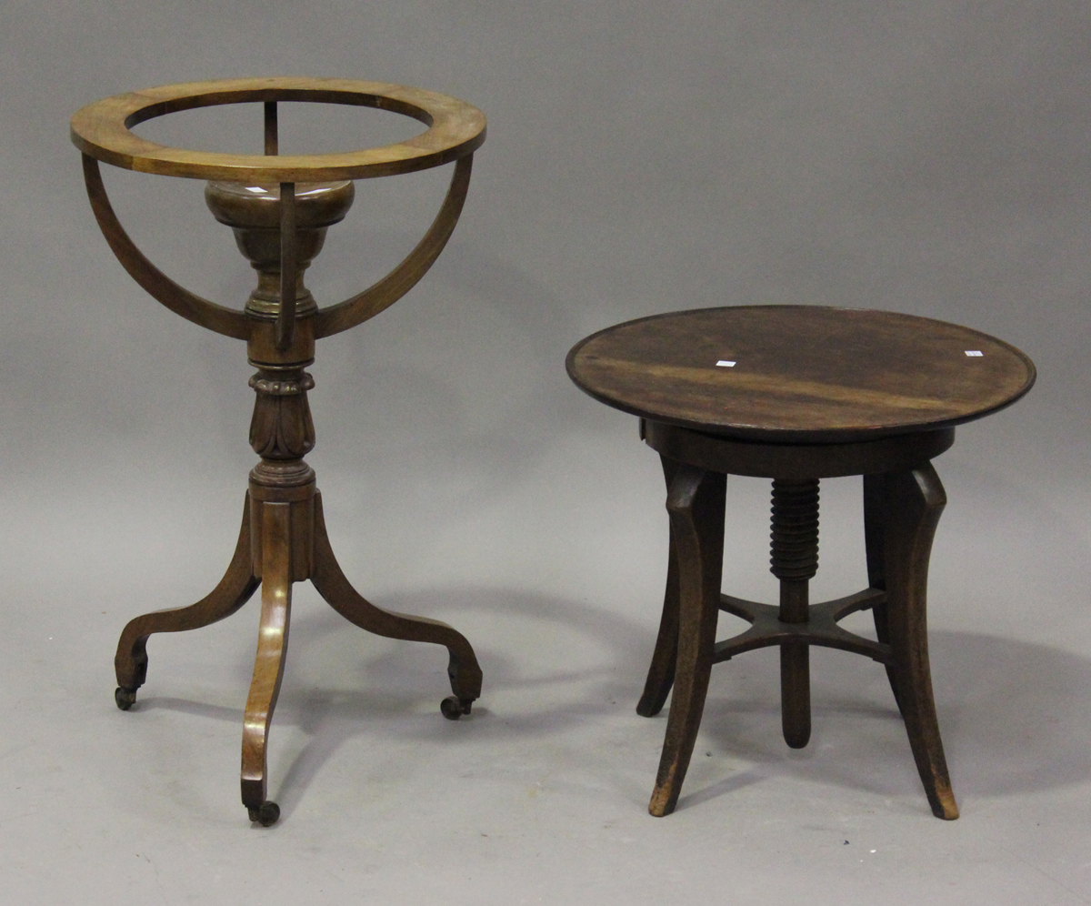 A Regency mahogany library globe stand, raised on a tulip cusp stem and tripod legs, height 70cm,