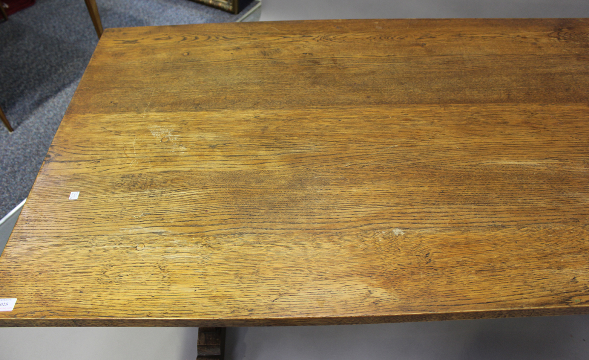 A 20th century oak refectory table, the rectangular top raised on shaped supports, height 75cm, - Image 5 of 5