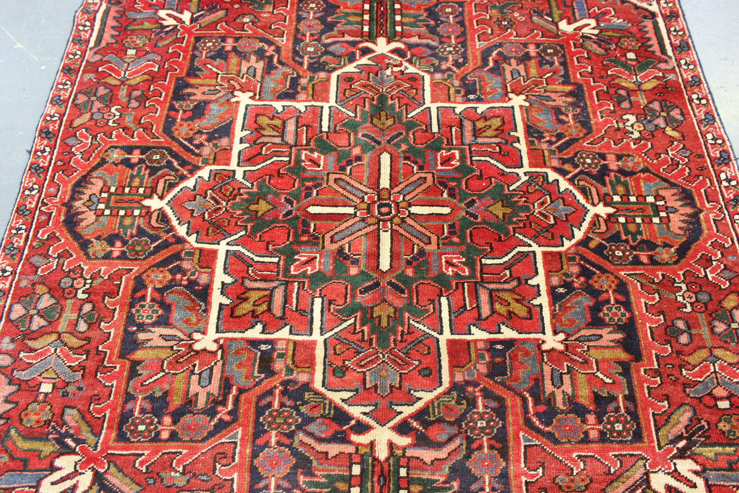 A Heriz rug, North-west Persia, mid-20th century, the terracotta field with a bold flowerhead - Image 3 of 5
