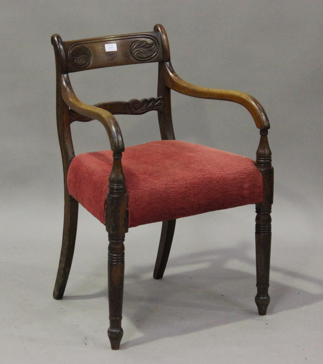 A Regency mahogany bar back elbow chair with carved back and red velour padded seat, height 82cm,