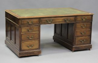 A good Edwardian walnut twin pedestal desk, possibly by Maple & Co, the top inset with green leather