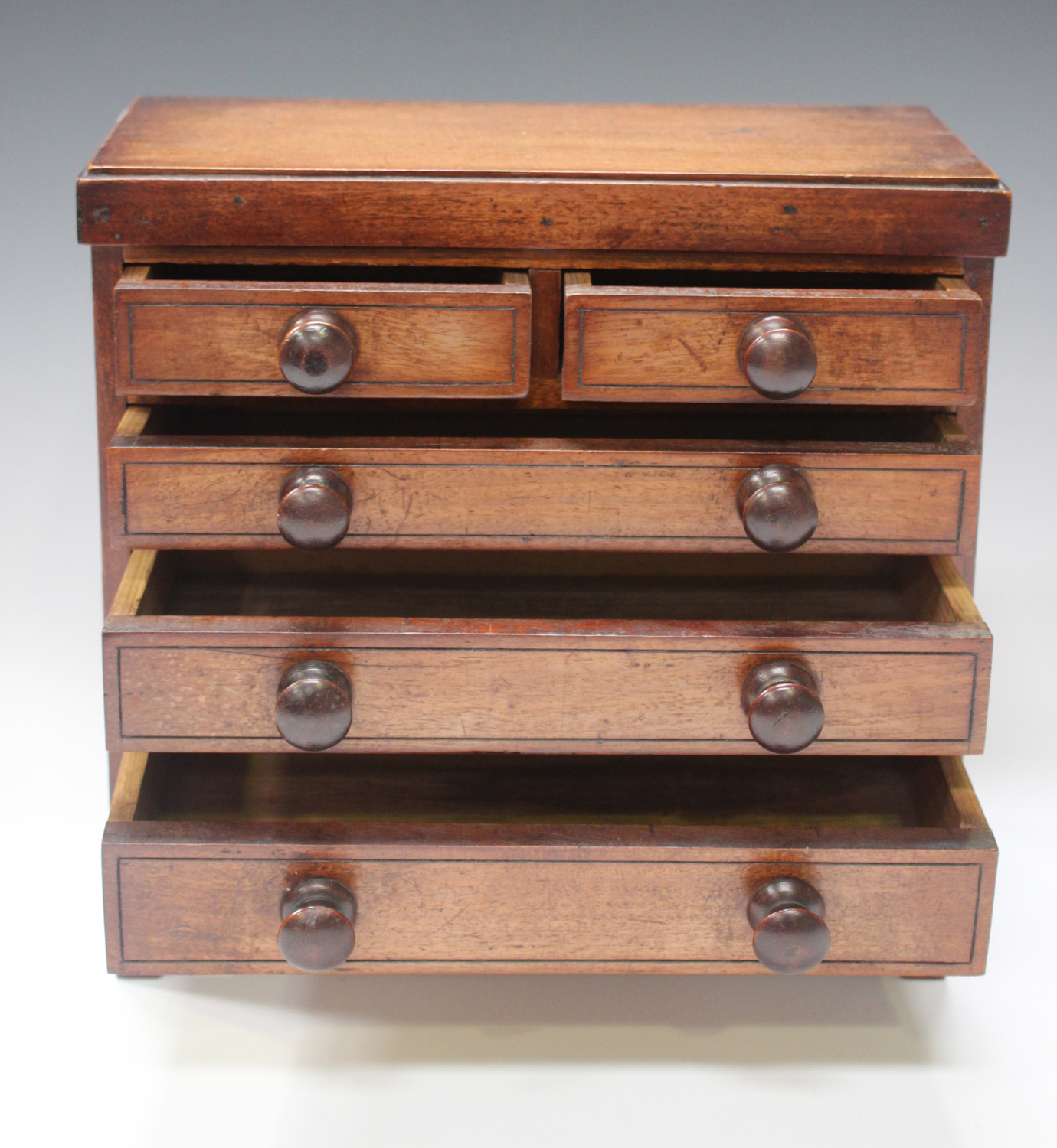 An early Victorian mahogany table-top apprentice chest of drawers, height 26cm, width 27cm.Buyer's - Image 8 of 8
