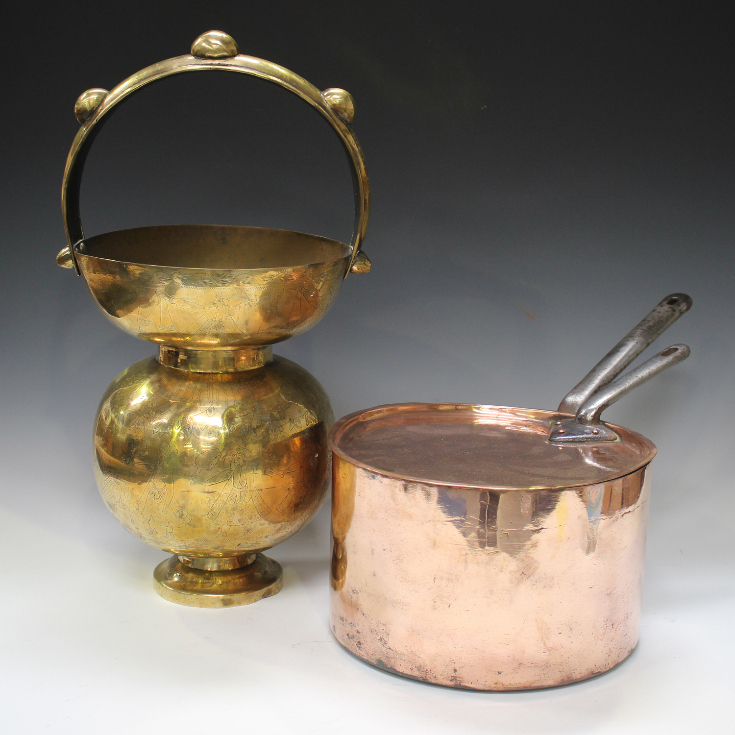 A late 19th/early 20th century copper cooking pan and lid, both with riveted steel handles, diameter