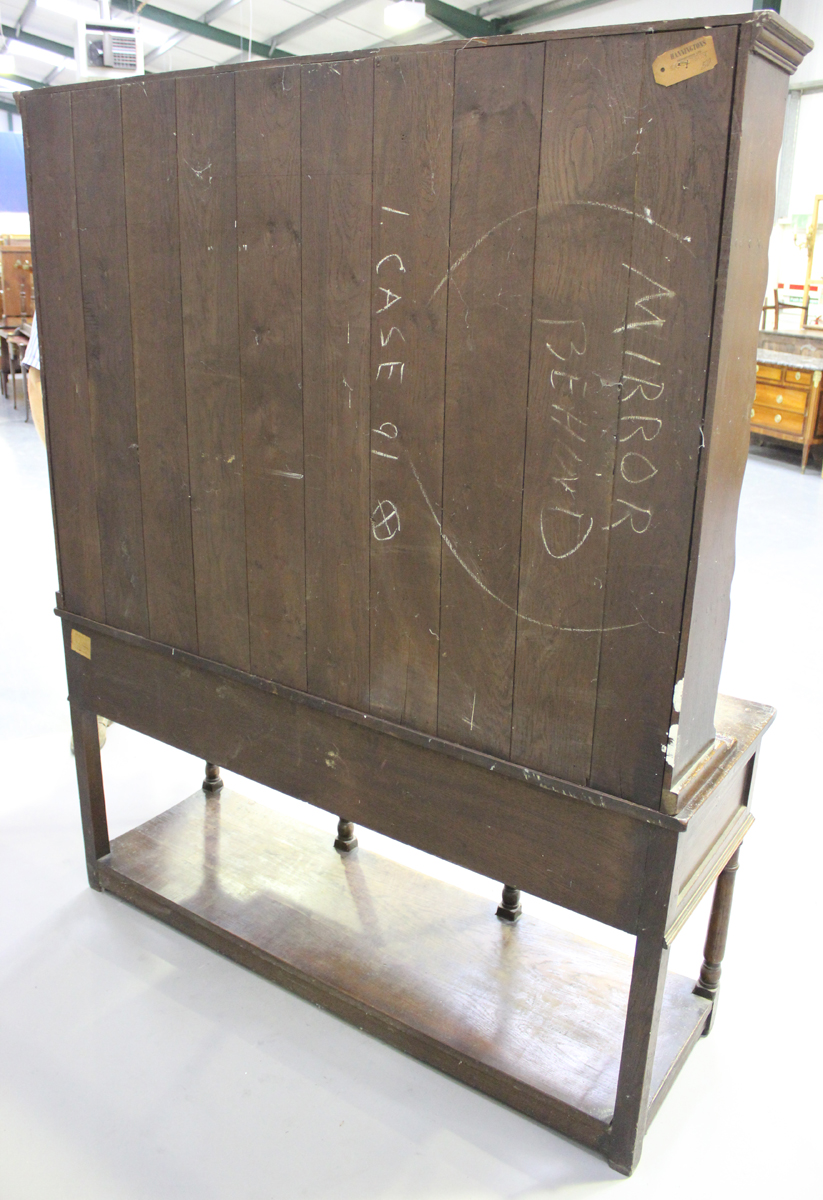 An early 20th century oak dresser, fitted with a plate rack above three drawers and a pot shelf, - Image 2 of 6