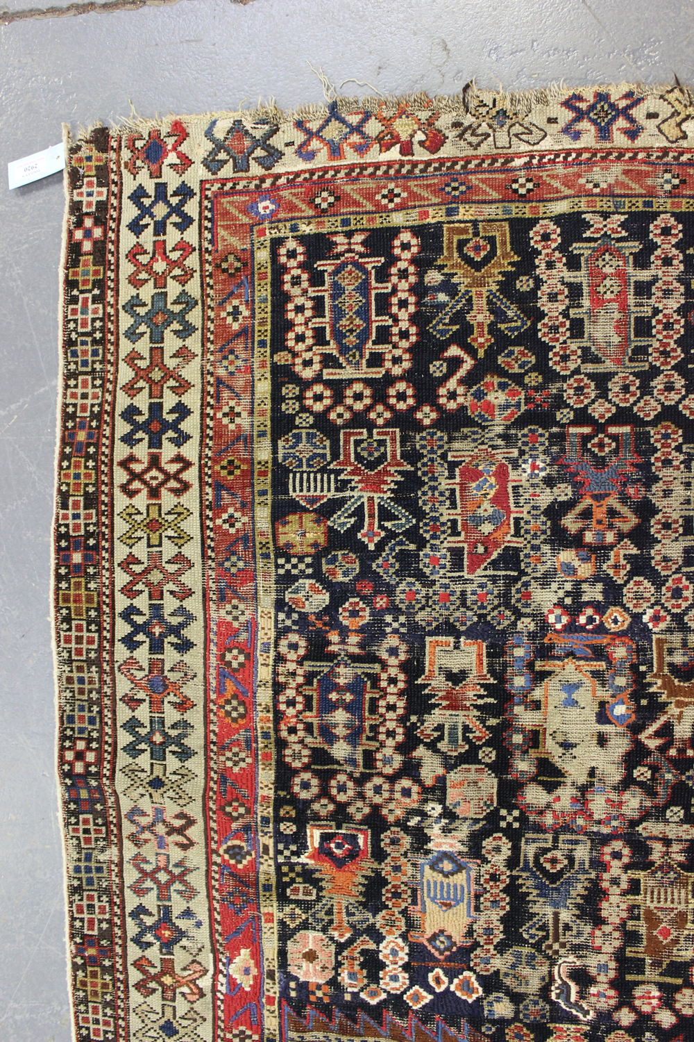 A Caucasian prayer rug, late 19th/early 20th century, the charcoal mihrab filled with boteh and - Image 3 of 5