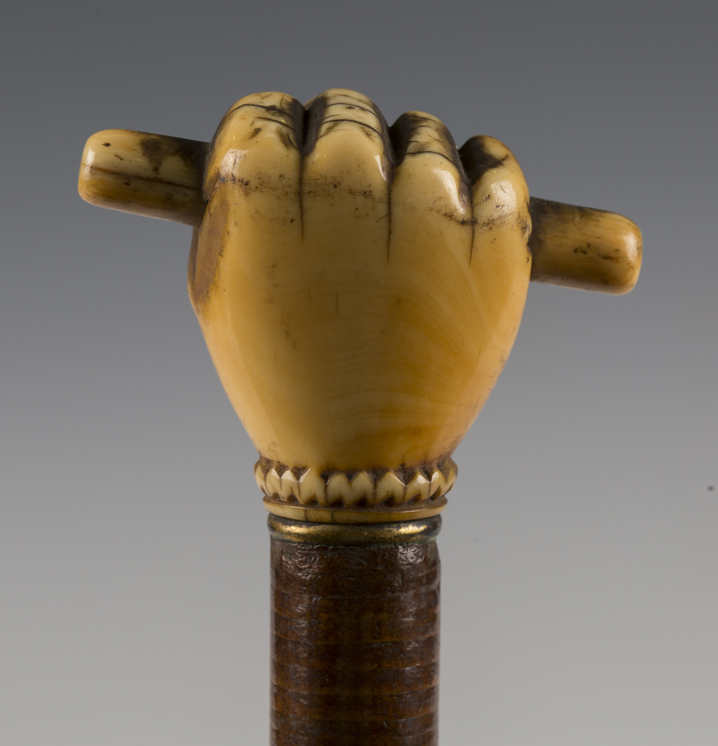 A 19th century sectional joined leather walking cane, the ivory handle carved as a hand holding a - Image 6 of 7