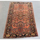 A Hamadan rug, North-west Persia, early 20th century, the pink field with central floral spray and