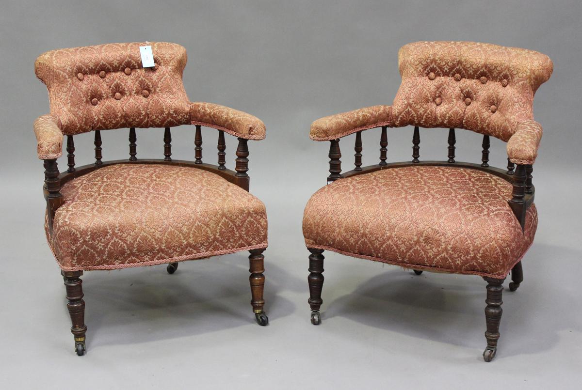 A pair of late Victorian walnut framed tub back salon armchairs, height 73cm, width 60cm, depth