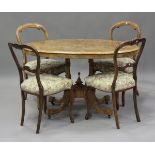 A late Victorian walnut and foliate inlaid oval tip-top centre table, height 73cm, length 118cm,
