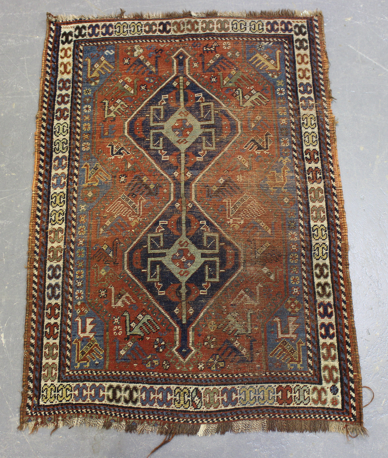 A Kamseh rug, South-west Persia, late 19th/early 20th century, the terracotta field with a pair of