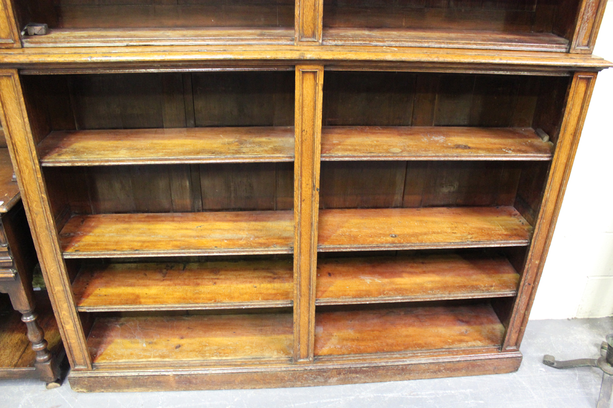 A Victorian oak open library bookcase, the moulded pediment above adjustable shelves, on a plinth - Image 5 of 5