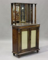 A William IV rosewood chiffonier, the canopied mirror back with gadrooned and foliate decoration,