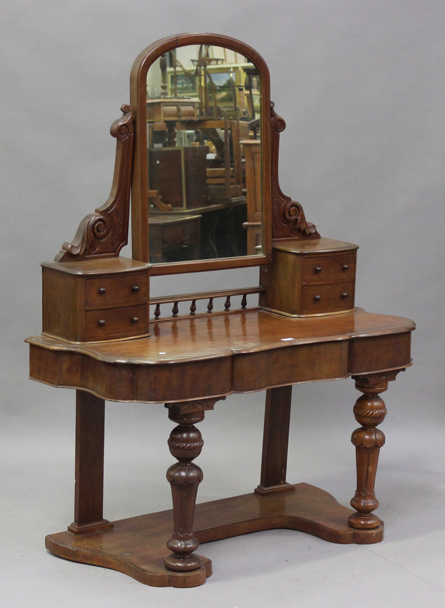 A late Victorian mahogany Duchess dressing table, the swing frame mirror above drawers, height