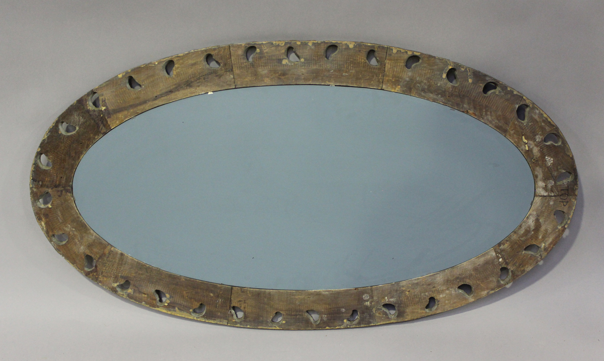 An early 20th century gilt painted, carved and moulded oval wall mirror, 121cm x 65cm.Buyer's - Image 2 of 3
