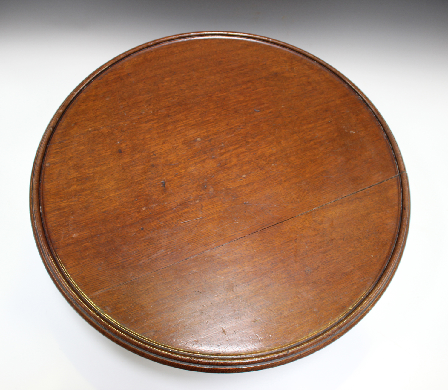 A late Victorian oak revolving lazy Susan, raised on a pierced frieze and scroll legs, height - Image 5 of 5