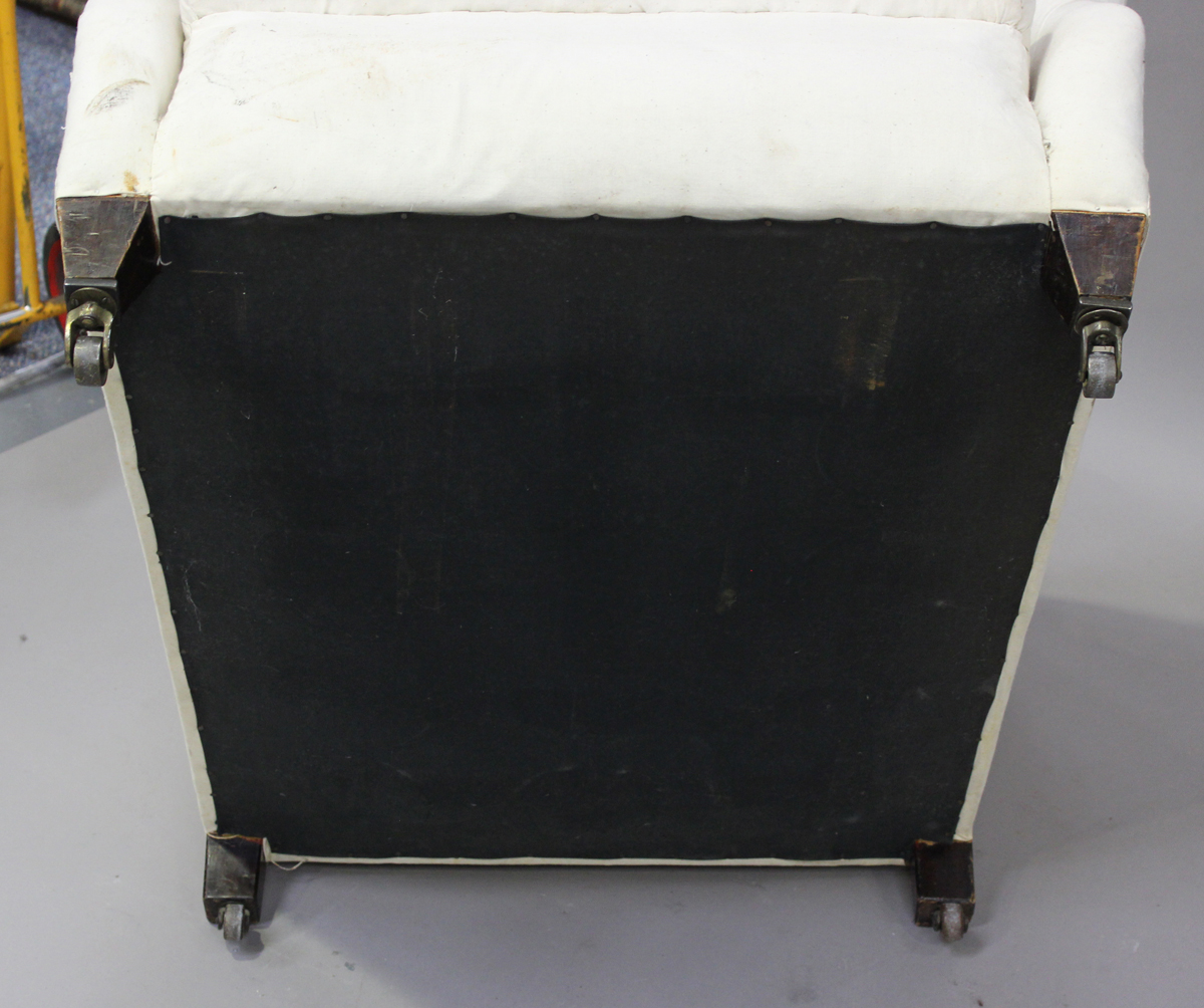 An Edwardian scroll armchair, in the manner of Howard & Sons, raised on square tapering legs, height - Image 3 of 5