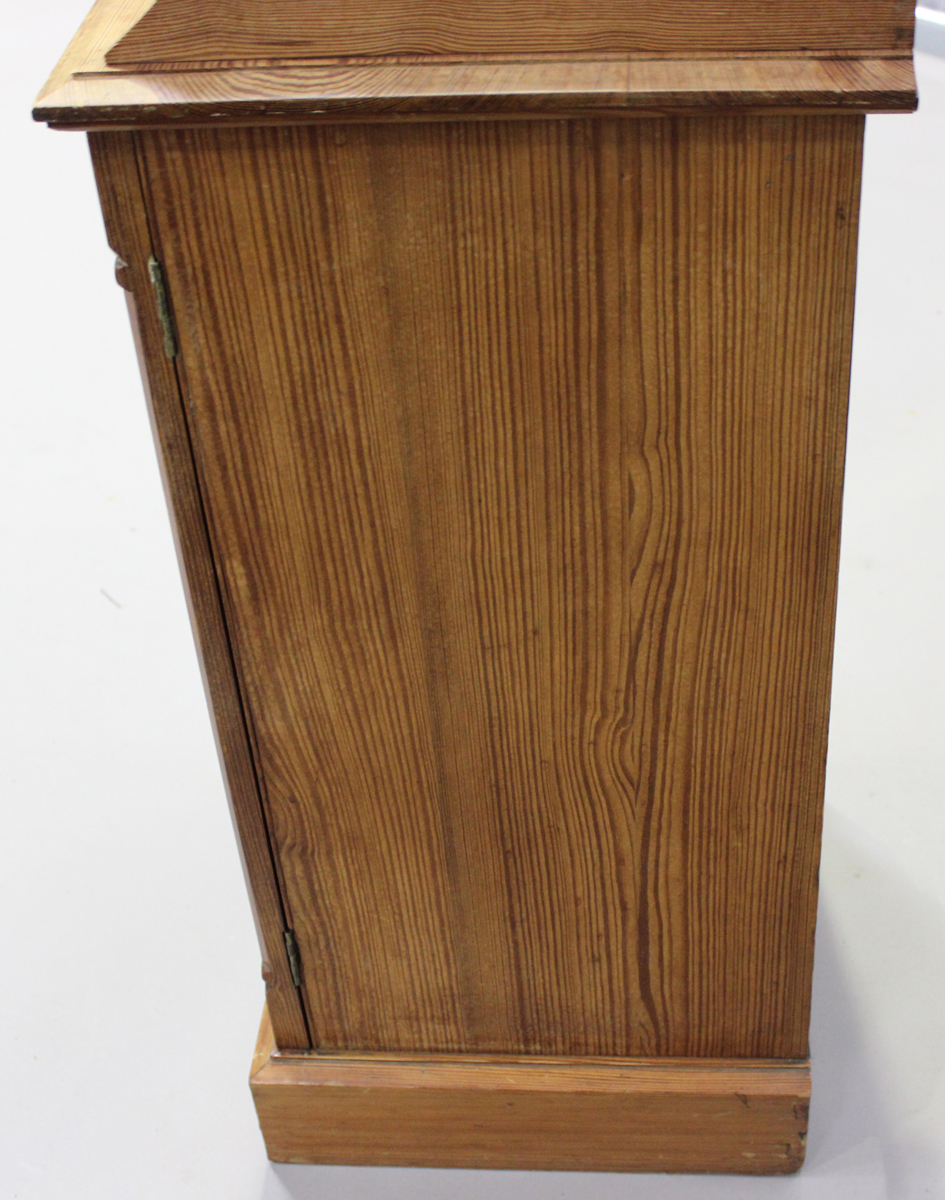 An early 20th century pitch pine bedside cupboard, height 83cm, width 39cm, depth 38cm.Buyer's - Image 3 of 6