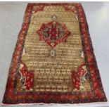 A Hamadan rug, North-west Persia, late 20th century, the taupe field with a shaped medallion, within
