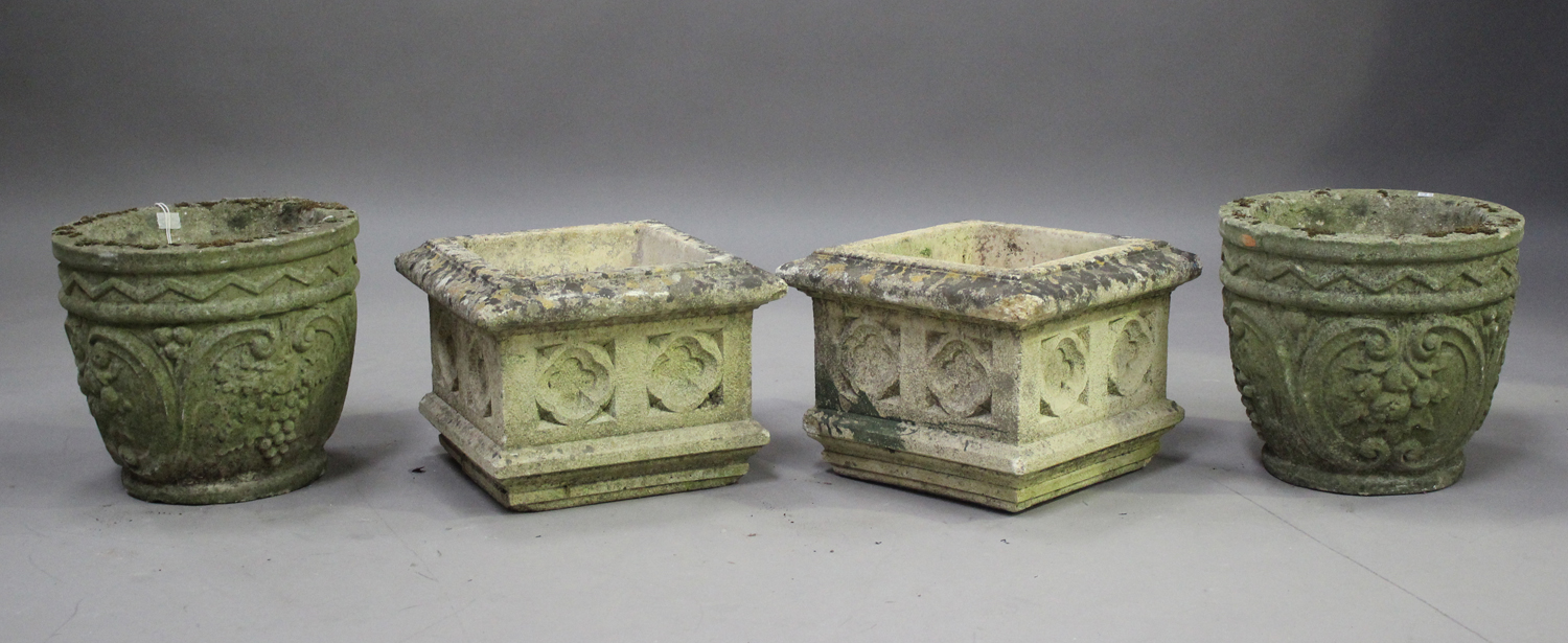 A pair of 20th century cast composition stone planters, decorated with grapes and scrolls, height