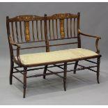 An Edwardian mahogany and foliate inlaid salon settee, height 94cm, width 128cm, depth 57cm.Buyer'