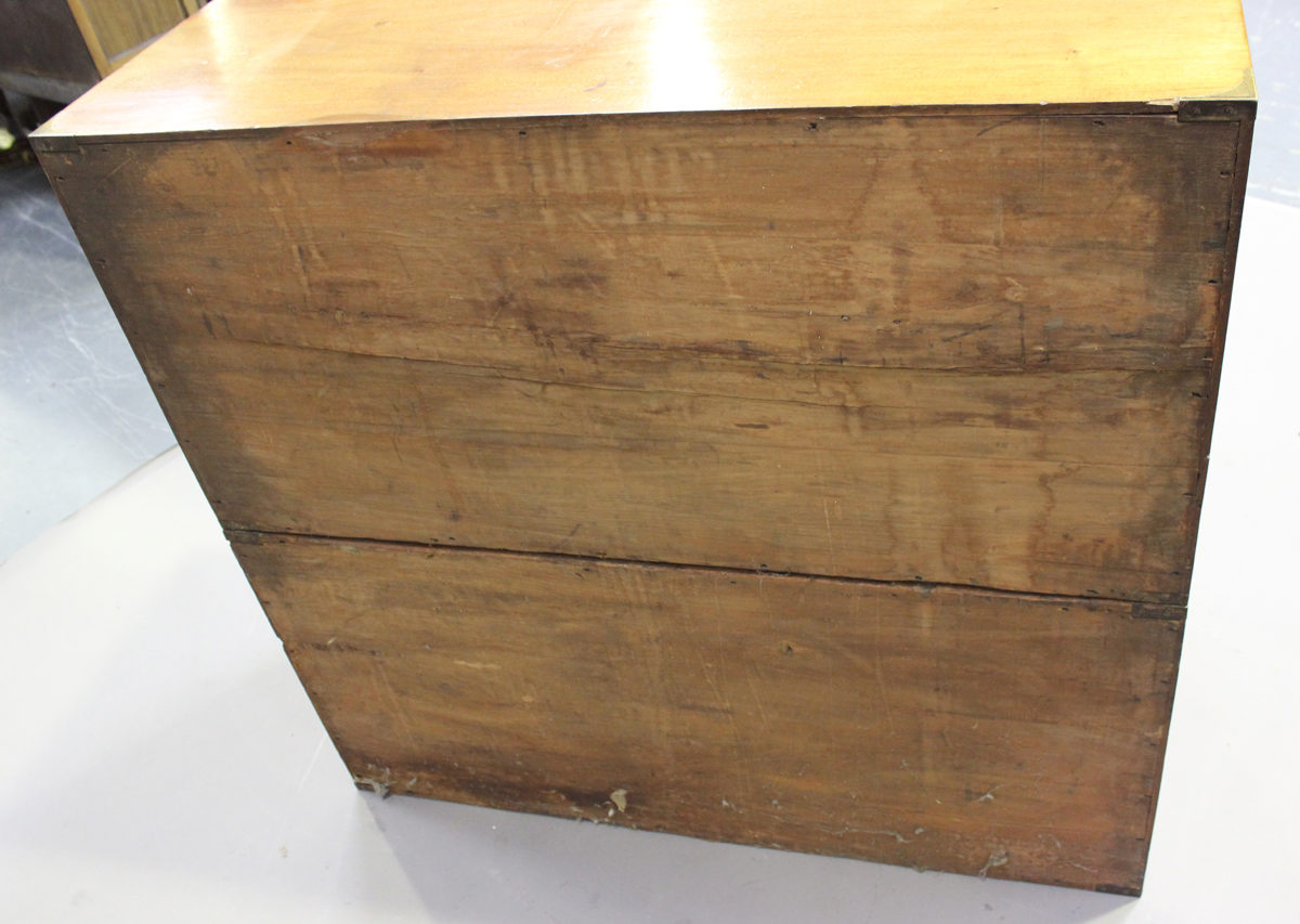 A late 19th century mahogany and brass bound campaign chest of three short and three long drawers, - Image 4 of 7