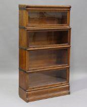 An early 20th century oak Globe Wernicke four-section glazed bookcase, height 156cm, width 87cm,