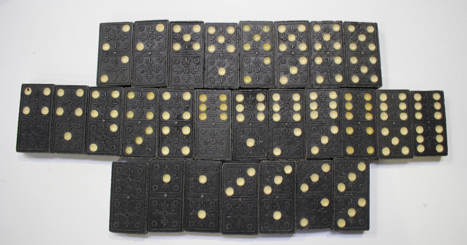 A quantity of bone and ebony dominoes, other sets of dominoes and various draught and chess pieces. - Image 3 of 8