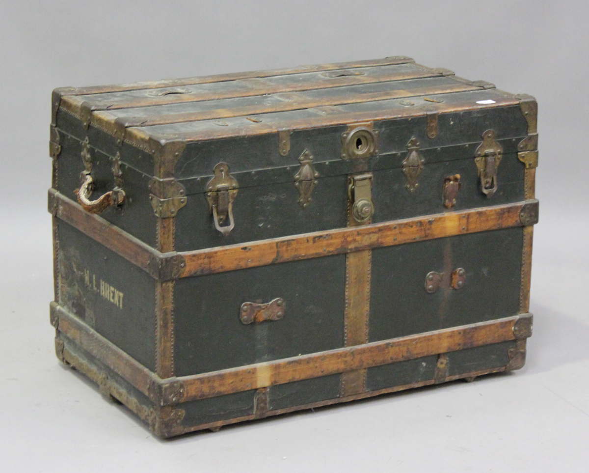 A late 19th century American brass bound travelling trunk by Henry Likly & Co, Rochester, New