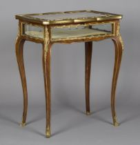 A good late 19th century Louis XV style kingwood bijouterie table with applied ormolu mounts, the