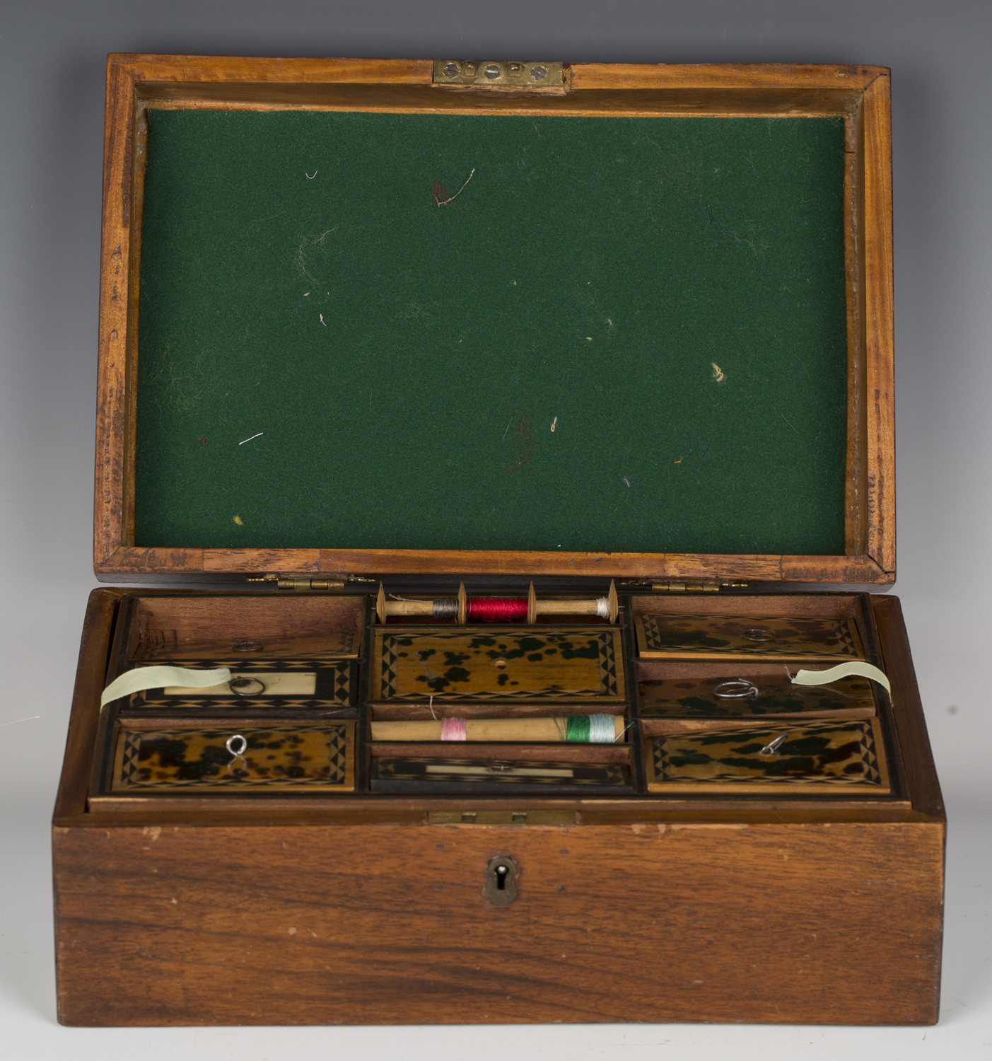 A late 19th century walnut workbox, the interior with a removable tray inset with tortoiseshell