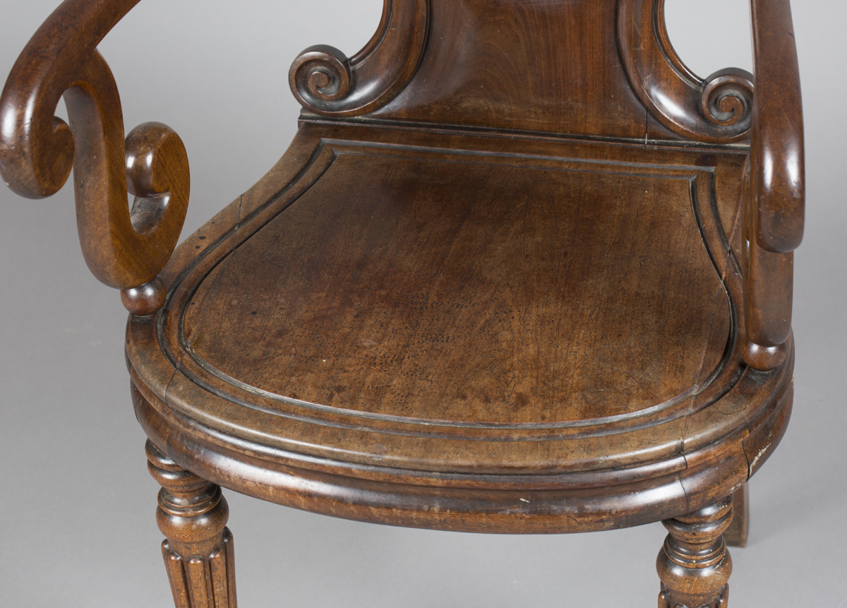 A William IV mahogany elbow hall chair, in the manner of Gillows of Lancaster, the shield back - Image 9 of 10