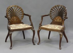 A pair of Edwardian Neoclassical Revival mahogany pierced fan back salon chairs with profusely