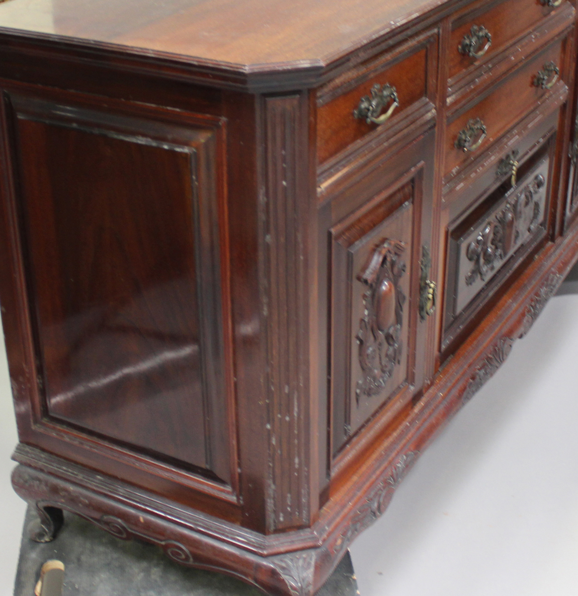 A late Victorian walnut sideboard with carved decoration, fitted with drawers and cupboards, - Image 3 of 4