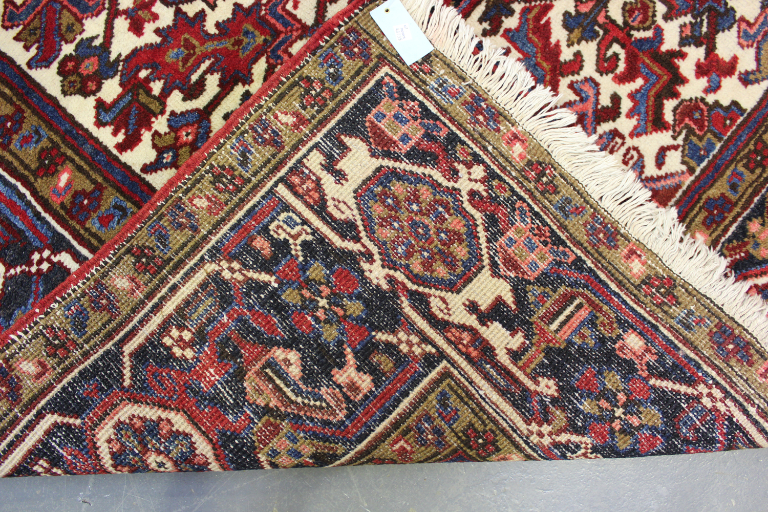 A Heriz carpet, North-west Persia, mid-20th century, the red field with a bold flowerhead - Image 2 of 6