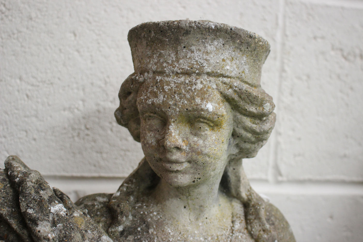 A near pair of late 20th century cast composition stone garden figures, raised on foliate - Image 4 of 4