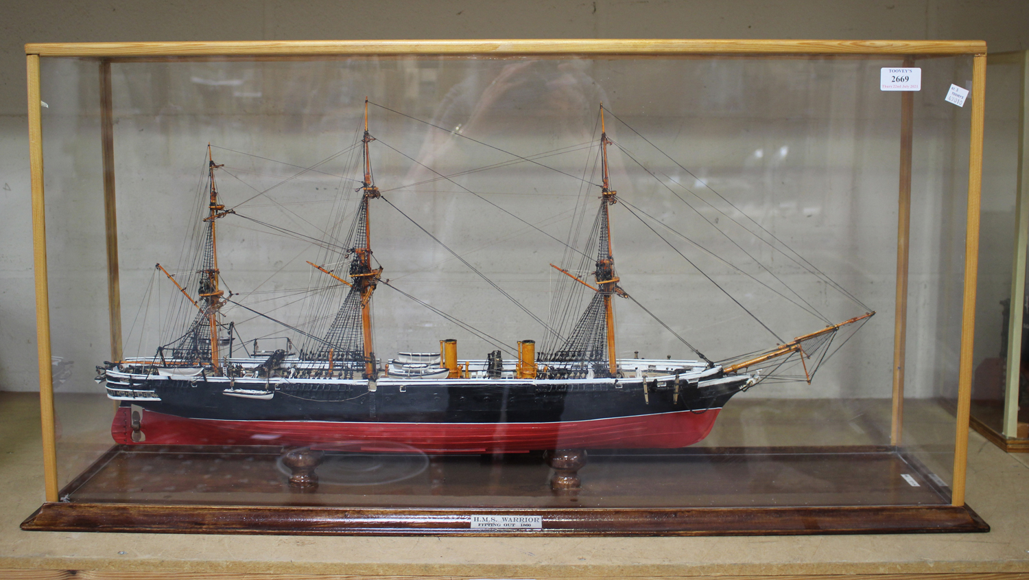 A modern 1:192 scale model of HMS Warrior, length 80cm, within a case.Buyer's Premium 29.4% (