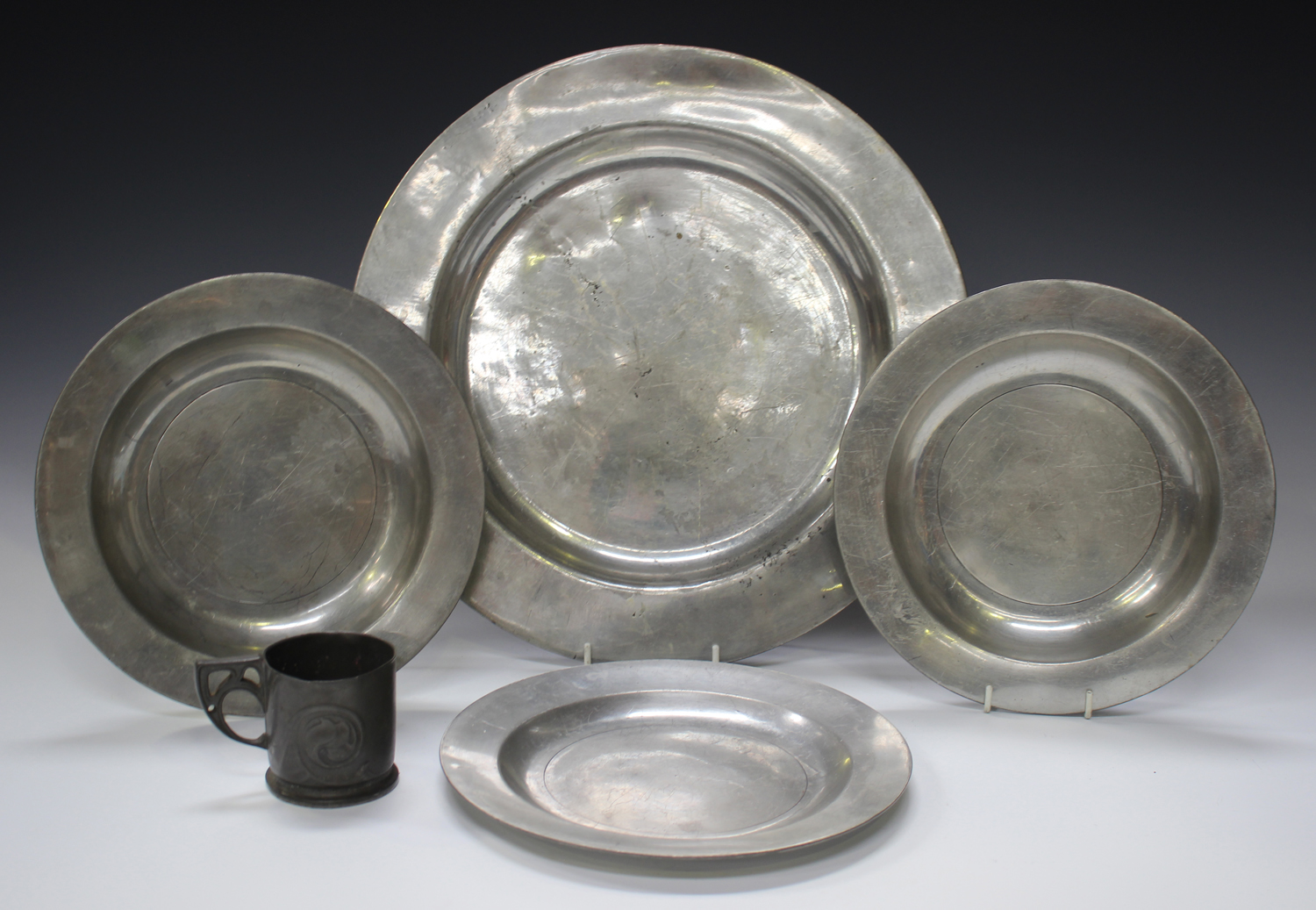 A small group of pewter items, comprising a Liberty 'Tudric' cup, model number '0558', height 6.5cm,