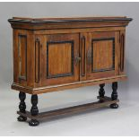 A 19th century Continental walnut side cabinet-on-stand, fitted with a pair of panel doors with