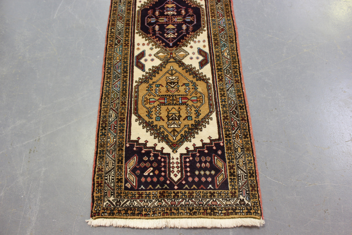 A Turkish runner, mid-20th century, the ivory field with a column of linked medallions, within a - Image 5 of 5