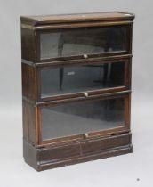 An early 20th century oak Globe Wernicke three-section glazed bookcase, height 115cm, width 86cm,