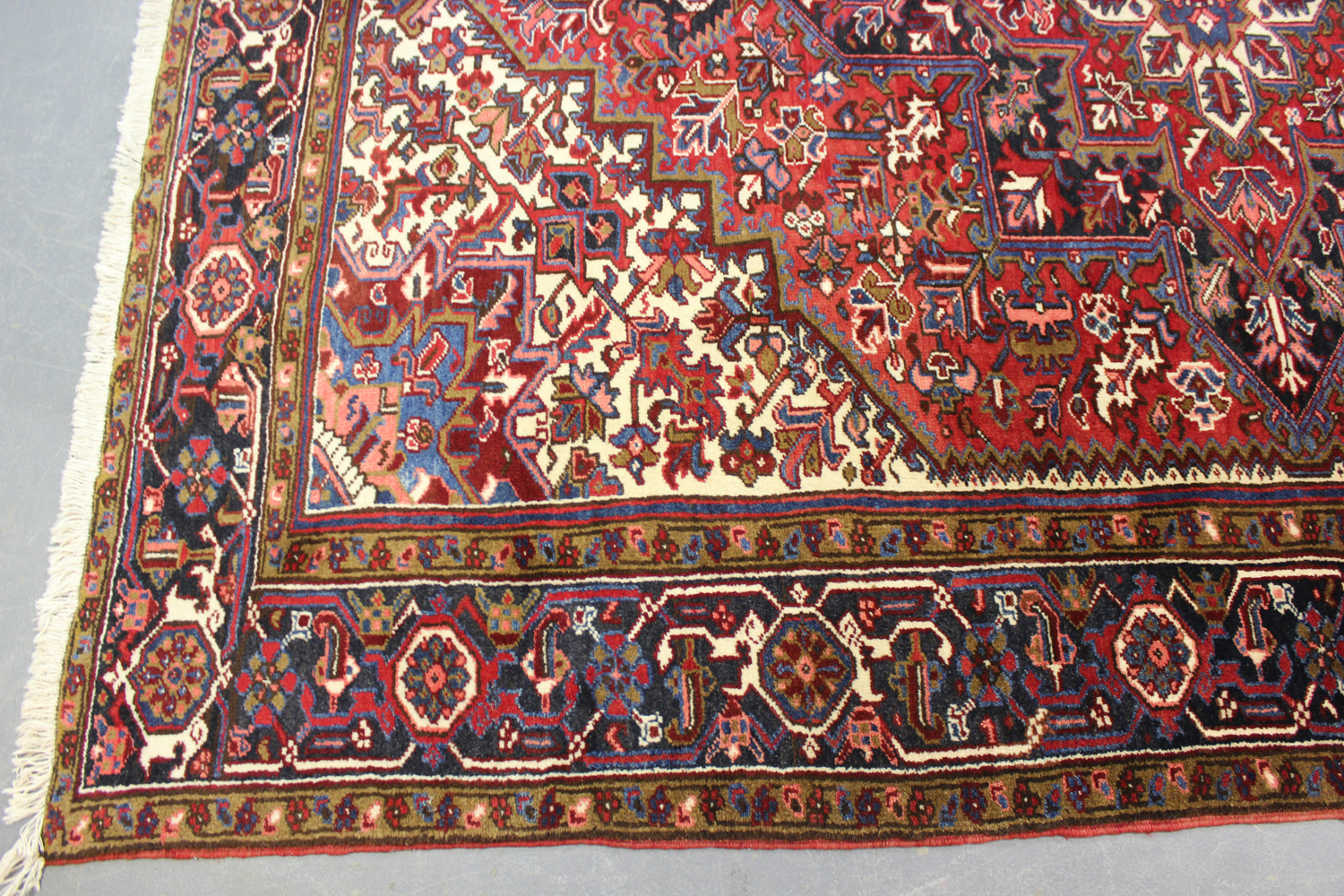 A Heriz carpet, North-west Persia, mid-20th century, the red field with a bold flowerhead - Image 3 of 6